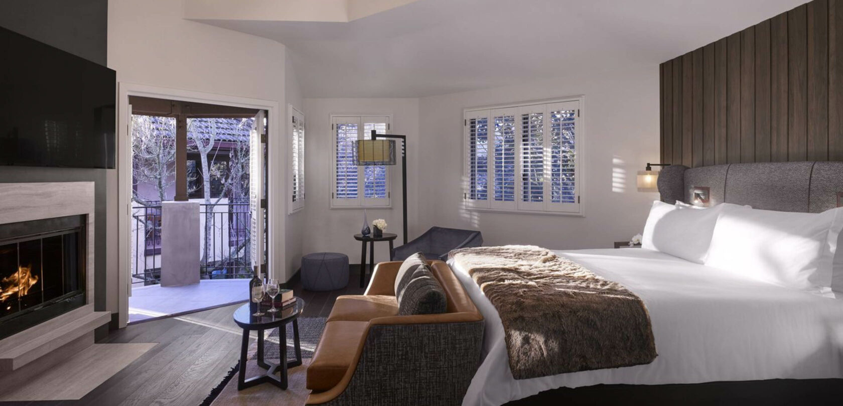 bed and tv in the Premium, Two Queen Beds room