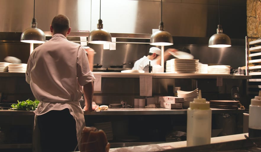 chefs cooking in a kitchen