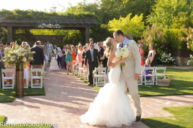 couple kissing at wedding ceremony