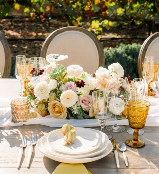 wedding table setting with flowers and plates