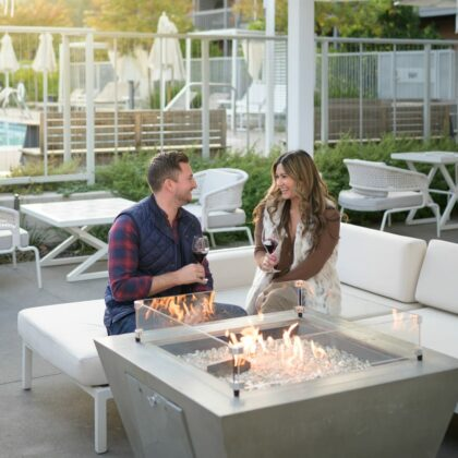 couple having drinks by the pool