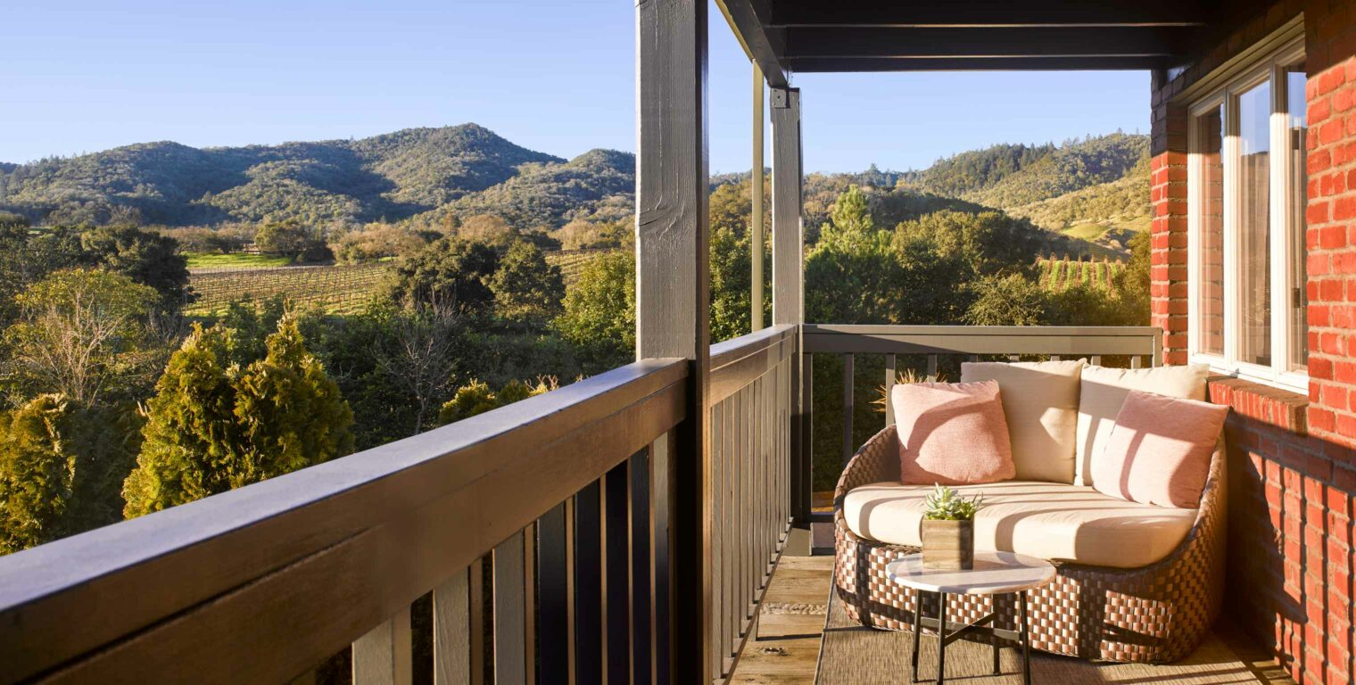 love seat on a balcony overlooking the napa valley
