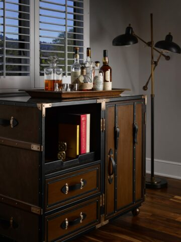 dresser with alcohol in the vintage house