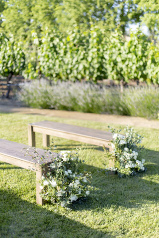 the vineyard close up benches with floral arrangements